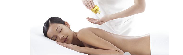 Woman being massaged / Woman having her face massaged